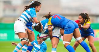 Colombia's Maria Arzuaga fights for the ball in the match against Argentina