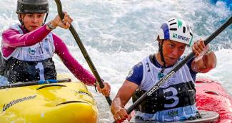 Paddler trying to overtake her opponent in an extreme canoe slalom championship.