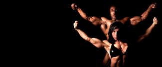A couple of bodybuilders perform a pose for the camera.