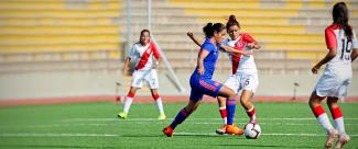 Female teams from Peru and Colombia face off in a match prior to Lima 2019.