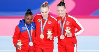 Cuban Yesenia Ferrera(silver), and Canadians Elsabeth Black(gold), along with Shallon Olsen(bronze) at Lima 2019