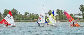 Athletes trying to pass through their opponents during the sailing competition