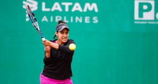 Veronica Cepede from Paraguay faces off Carolina Alves from Brazil in the Lima 2019 tennis competition at the Lawn Tennis Club