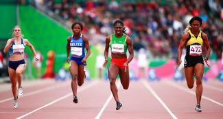 Four female runners give their best in the 100 m race held at the National Sports Village – VIDENA, at the Lima 2019 Pan American Games