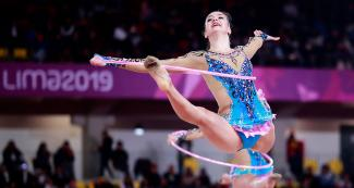 American gymnast performing extraordinary turn at the Villa El Salvador Sports Center in the Lima 2019 Games