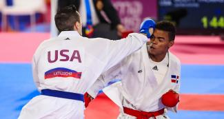 USA's Thomas Scott throws a punch at Anderson Soriano from the Dominican Republic, during the Lima 2019 Games karate competition at the Villa El Salvador Sports Center.
