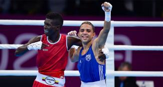 Yuberjen Martinez from Colombia and Oscar Collazo from Puerto Rico embrace each other on the ring after competing at the Callao Regional Sports Village