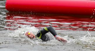 A swimmer moving through the water in the 10 km open water final held at Laguna Bujama