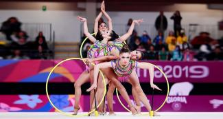 Brazilian gymnasts showing coordination at the Villa El Salvador Sports Center in the Lima 2019 Games