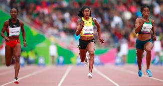 Jamaican athlete Elaine Sandra Lee runs the 100 m race at the Lima 2019 Games, at the National Sports Village –VIDENA