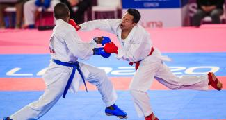 Guatemalan Allan Maldonado retaliates against Brazilian Hernani Verissimo in karate kumite during the Lima 2019 Games, at the Villa El Salvador Sports Center.