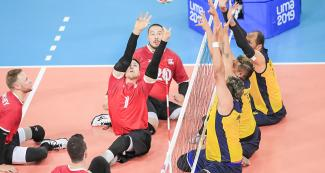 Canadian Jesse Ward focused on the ball in Lima 2019 sitting volleyball match against Colombia held at the Callao Regional Sports Village