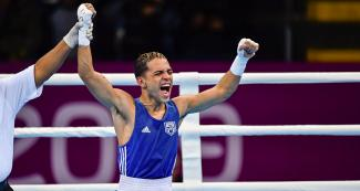 Boxer Oscar Collazo bursts into joy after competing in the men's flyweight category at the Lima 2019 Games