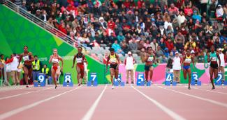 Female athletes run 100 m race course at the Lima 2019 Games, at the National Sports Village –VIDENA