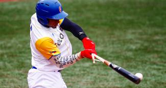 Cristian Cano shatters his bat by ferociously hitting the ball in the match against Nicaragua at the Villa María del Triunfo Sports Center during Lima 2019 Games