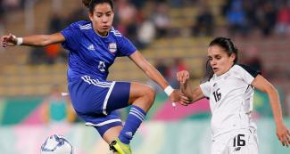 Paraguay's Fabiola Sandoval faces off Costa Rican midfielder Katherine Alvarado for the women's football bronze medal at San Marcos Stadium