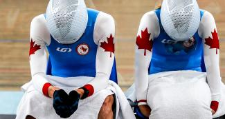 Canada's Carla Shibley and her pilot Meghan Lemiski resting after winning the Para cycling track competition at the National Sports Village – VIDENA, Lima 2019