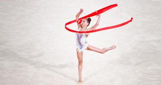 ymnast Camilla Feeley performs her routine at the Villa El Salvador Sports Center