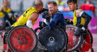 American Lee Fredette and Colombian John Orozco fight for the ball in the Lima 2019 wheelchair rugby match at the Villa El Salvador Sports Center