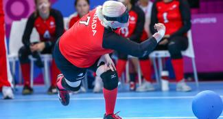Canadian Amy Burk kicks the ball during a match vs. Mexico during Lima 2019 women's goalball competition at the Callao Regional Sports Village.
