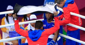 Cuban David Caballero in a corner of the ring during the competition against the US boxer held at the Callao Regional Sports Village