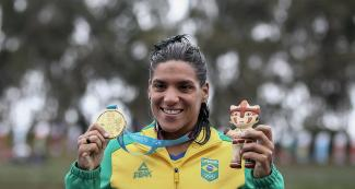 Ana Marcela Soares from Brazil posing with her gold medal after the 10 km Open Water Final held at Laguna Bujama