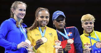 Boxers Virginia Fuchs from the USA (silver medal), Ingrit Valencia from Colombia (gold medal), Miguelina Hernandez from the Dominican Republic and Irismar Cardozo from Venezuela (bronze medal) won the women's category at Lima 2019