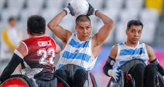 Argentinian Matías Cardozo and Chilean Francisco Cayulef fight for the ball in the Lima 2019 wheelchair rugby match at the Villa El Salvador Sports Center