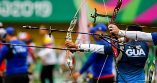 Lima 2019 Games men's team recurved bow ready to release arrows at Villa María del Triunfo Sports Center, Lima 2019 Games
