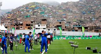Athletes from the Americas competing in the men's team recurved bow quarterfinals at Villa María del Triunfo Sports Center in the Lima 2019 Games