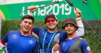 Juan Painevil Navarro, Ricardo Soto Pedraza and Andrés Aguilar Gimpel of the recurved bow Chilean team celebrating at the Villa María del Triunfo Sports Center, Lima 2019 Games