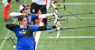 Vinicius Dalmeida Marcuso from Brazil aiming with his recurved bow at the villa María del Triunfo Sports Center, Lima 2019 Games