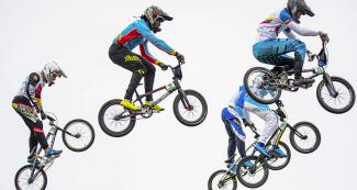 BMX racers meet mid-air during the Lima 2019 quarterfinals at Costa Verde San Miguel