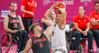 Colombian Jhon Hernandez tries to defend the ball from Canadian Robert Hedges during a wheelchair basketball game at the National Sports Village – VIDENA, at Lima 2019