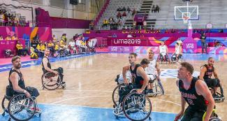 The Canadian players watch the ball enter the basket during their wheelchair basketball game against Colombia at the National Sports Village – VIDENA, at Lima 2019