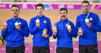 John Croom, Gavin Hoover, Ashton Lambie, and Adrian Hegyvary of the United States' track cycling team receive gold medals at the Callao Regional Sports Village.