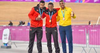 Njisane Phillip and Nicholas Paul of Trinidad and Tobago, and Kevin Quintero of Colombia show their silver, gold and bronze medals, respectively, in track cycling at the Callao Regional Sports Village.
