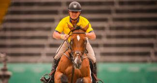 Diego Javier Vivero riding his horse during equestrian individual jumping training session at the Army Equestrian School