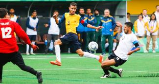 Brazilian Hebert Lemes faces Argentinian Pablo Molina for the ball in football 7-a-side at the Villa María del Triunfo Sports Center, at Lima 2019
