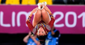 tish Hernández from Colombia performs a stunt in the trampoline competition at the Lima 2019 Games held at the Villa El Salvador Sports Center