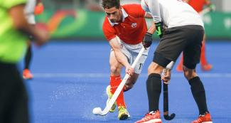 Chilean Ricardo Achondo vs. Canada in the hockey semifinal at the Villa Maria del Triunfo Sports Center, Lima 2019 Games