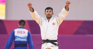 Peruvian judoka Alonso Wong celebrates his victory against Mexican Eduardo Araujo in the Lima 2019 men's -73 kg competition at the National Sports Village – VIDENA