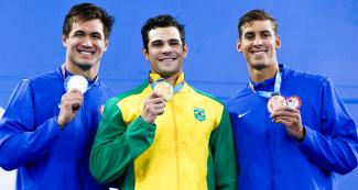 Nathan Adrian from the USA (silver), Marcelo Chierghini from Brazil (gold) and Michael Chadwick from the USA (bronze) pose with their Lima 2019 medals in men's 100 m freestyle at the National Sports Village – VIDENA