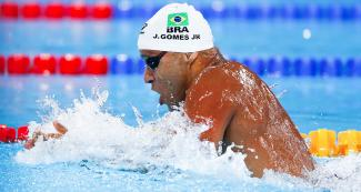 Brazilian Joao Luiz Gomes competing in mixed 4x100 m medley relay held at the National Sports Village – VIDENA