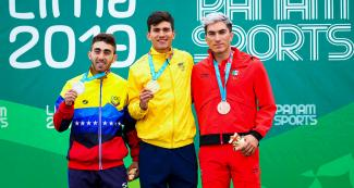 Jhoan Guzmán of Venezuela (silver), Pedro Causil of Colombia (gold) and Jorge Luis Martínez of Mexico (bronze) proudly posing with their medals in the men's 300 m time trial event at the Lima 2019 Games