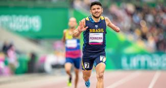 Brazilian Para athlete Petrucio Ferreira shows his speed in the 400m T47 at the National Sports Village – VIDENA at Lima 2019