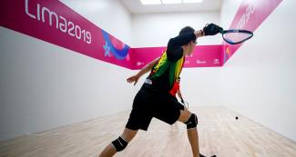 Carlos Keller from Bolivia gets ready to hit the ball during the Lima 2019 racquetball match against Canada at the Callao Regional Sports Village