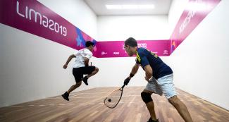 Racquetball player Coby Iwaasa from Canada faces off Sebastián Franco from Colombia during the men's round of 16 at the Callao Regional Sports Village