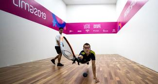 Racquetball player Coby Iwaasa from Canada goes up against Sebastián Franco from Colombia during the men's round of 16 at the Callao Regional Sports Village