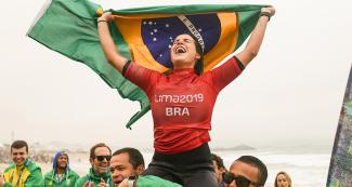 Chloe Calmon from Brazil celebrates her victory in surfing at the Lima 2019 Games, in Punta Rocas